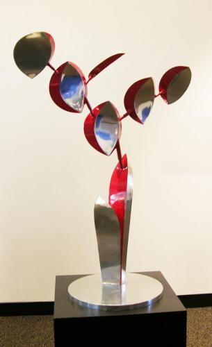Lin Emery (American, b. 1928). Maquette for Flowering, 1994. Polished aluminum with red urethane paint, 54x36in. Leepa-Rattner Museum of Art, St. Petersburg College, gift of The Patricia A. And Thomas J. Lehnen Family Art Collection, 2006.10